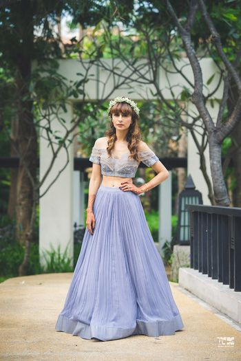 Photo of Mehendi look with lavender lehenga and floral crown