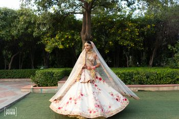 Photo of White floral print sabysachi bridal lehenga