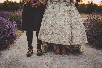 Photo of Bride and groom portrait showing shoes