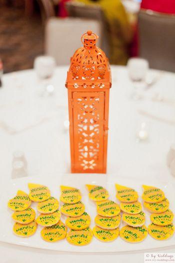 Mehendi favour ideas with orange cookies