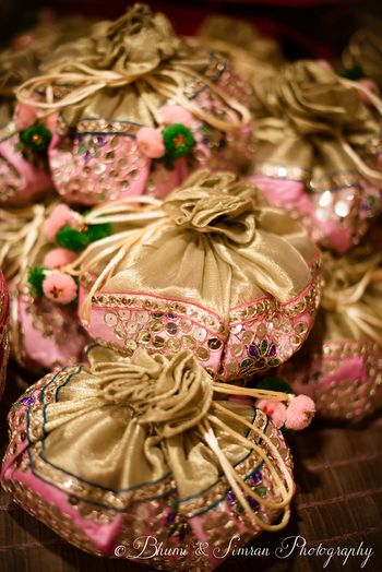 Gold potlis with pink work,