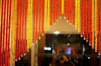 Photo of yellow and orange genda flower strings