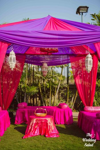 Photo of Mehendi decor idea with pink and purple tents and theme