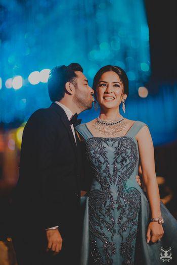 Groom kissing bride sangeet shot