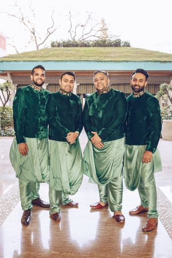 Groomsmen in draped kurta and green jackets
