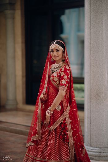 Photo of A bride in a red lehenga