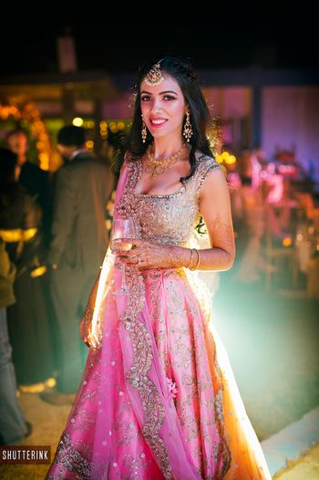 Photo of Light pink lehenga with scalloped dupatta edge