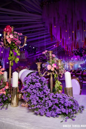 Pretty and elaborate floral decor for reception in shades of purple