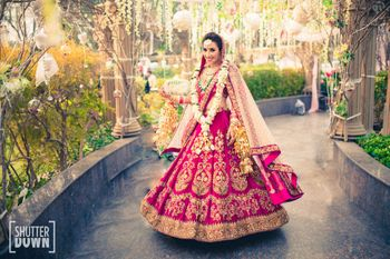 Photo of Pomegranate pink bridal lehenga by Sabyasachi
