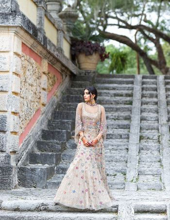 Photo of Engagement lehenga with cape and florals