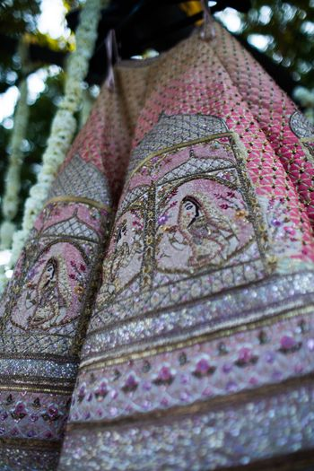 Light pink bridal lehenga with unique embroidery on it