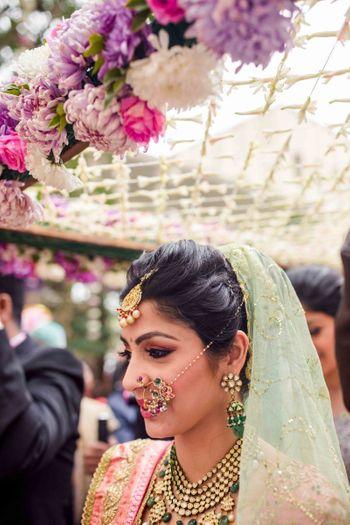 Photo of Bride entering wearing elaborate nosering