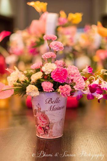 Floral roses in vintage bucket