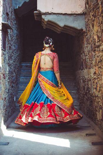 Turquoise and red wedding lehenga
