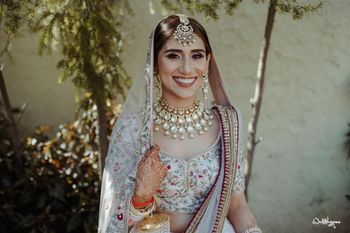 Photo of bridal jewellery with simple but statement maangtikka and necklace
