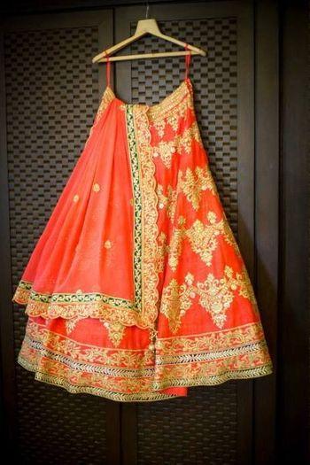 Coral bridal lehenga by Tamanna Punjabi Kapoor