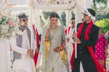 Photo of Offbeat bridal lehenga bride making entry
