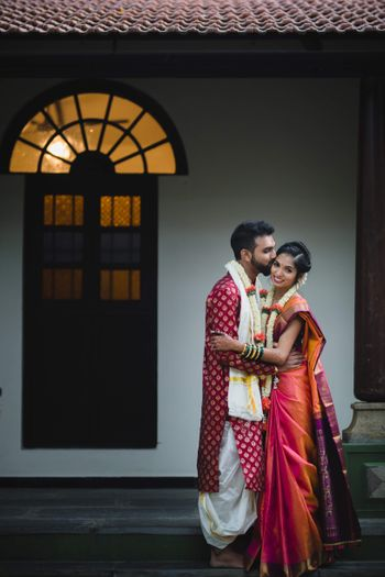 A color-coordinated south Indian couple on their wedding day