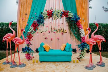 Photo of Mehendi couple seat with tropical theme