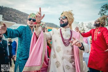 Photo of Baraat photo with groom in off white sherwani
