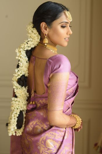 Photo of south indian floral bridal braid with mogra