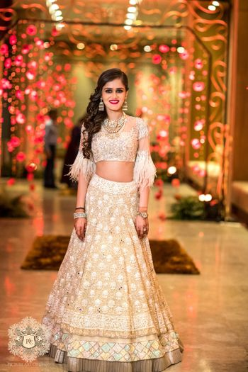 Photo of Manish malhotra white lehenga with frill