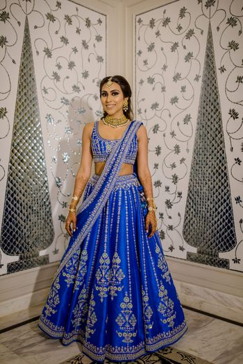 Photo of Bride wearing an electric blue lehenga on her Sangeet.