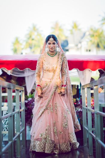 A gorgeous bridal entry of a bride in pink