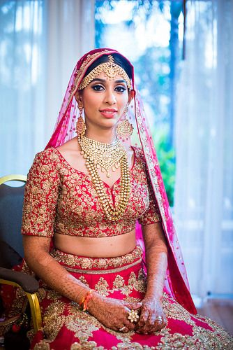 Bride in red with layered jewellery