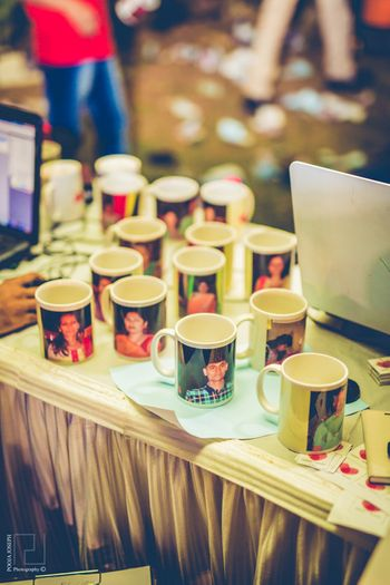 Photo of Have a photographer give instantly printed photos on mugs as wedding favors