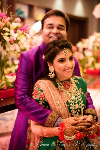 Photo of Bride and groom contrast outfit on sangeet