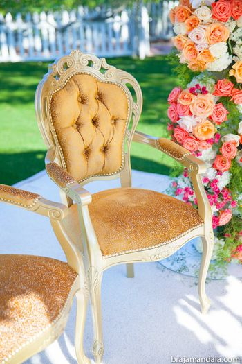 Gold cushion chair at mandap