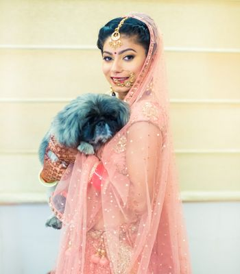 Indian bride posing with pug