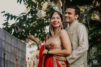 A to be bride and groom pose together on their mehndi