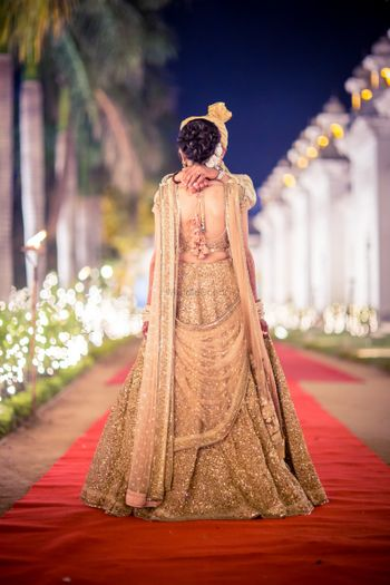 Photo of Bridal back on rose gold sequin lehenga