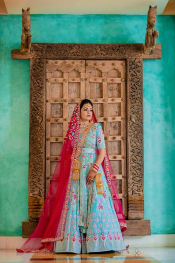 light blue offbeat bridal anarkali with bright pink dupatta
