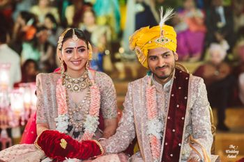matching bride and groom with a contrasting yellow safa