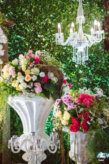 Photo of floral decor idea for wedding with hanging chandelier