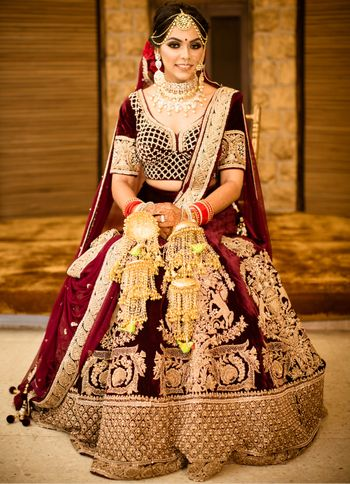Photo of Winter wedding velvet maroon lehenga