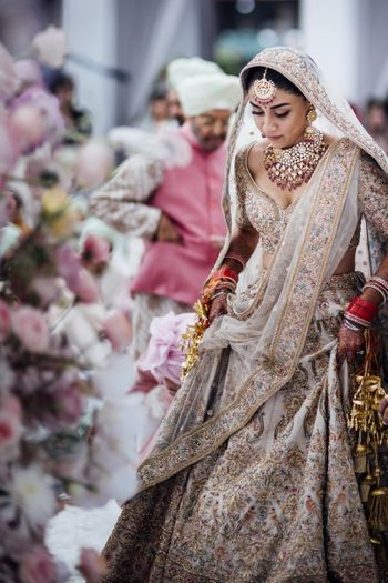 Photo of Sabyasachi lehenga on Amrita puri with floral motifs