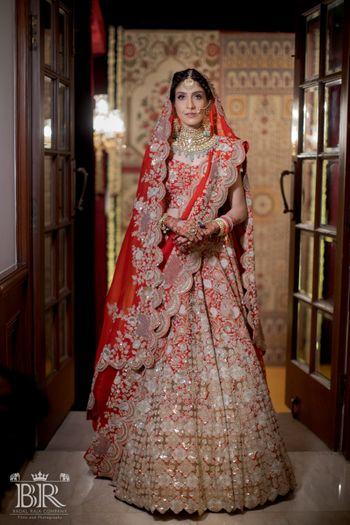 Bride in a red Anamika Khanna Lehenga