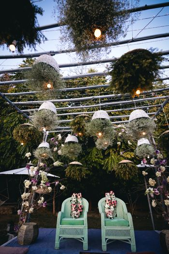 Unique mandap decor with suspended cane baskets