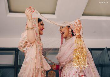 Fun & cute bride & bridesmaid photograph.