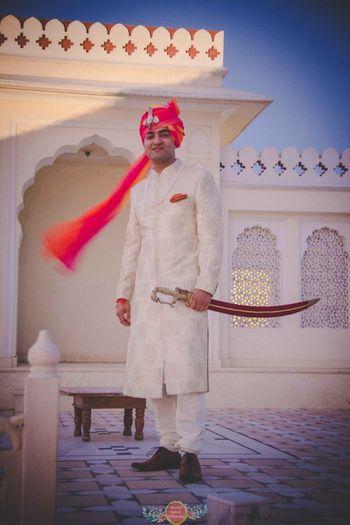 Tye dye safa on groom with white sherwani