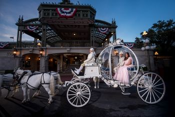 Indian bride and groom sit inside a carriage on their destination wedding at Disney World, Orlando