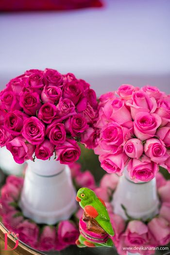 Photo of Pink roses as table centerpieces