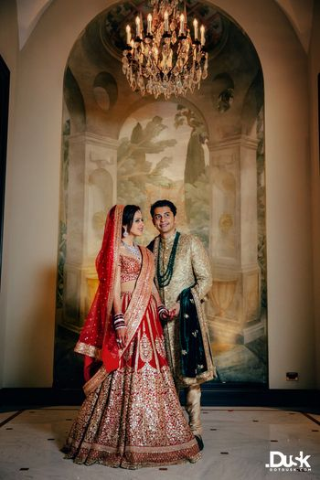 Red Sabyasachi bridal lehenga and groom