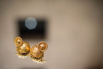 Photo of delicate gold jhumkis