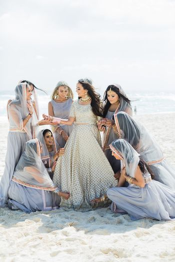 Bridesmaids in grey wearing dupattas on head