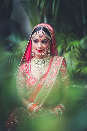 Bridal portrait in red bridal lehenga and simple jewellery